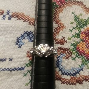 Size 6 stamped 925. White sapphires